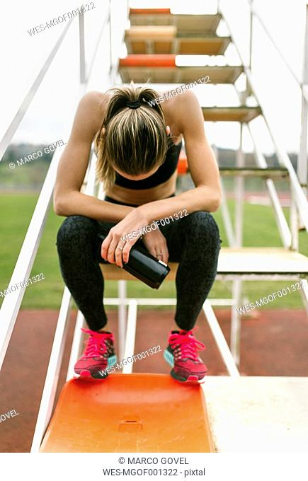 Athlete woman recovering after training