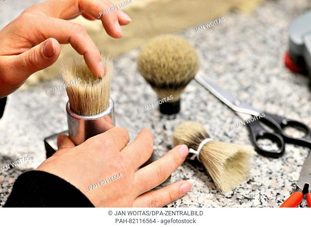 An employee of the company Hans-Juergen Mueller GmbH moulds a bundle of badger hair for a shaving brush in Stuetzengruen,Germany, 24 May 2016
