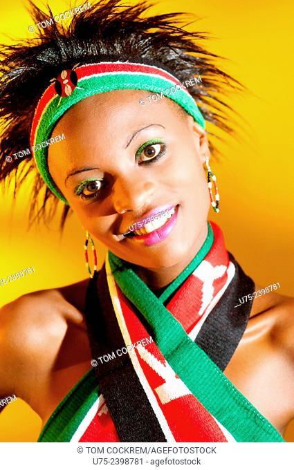 Young Kenyan woman with Kenyan colors in studio setting