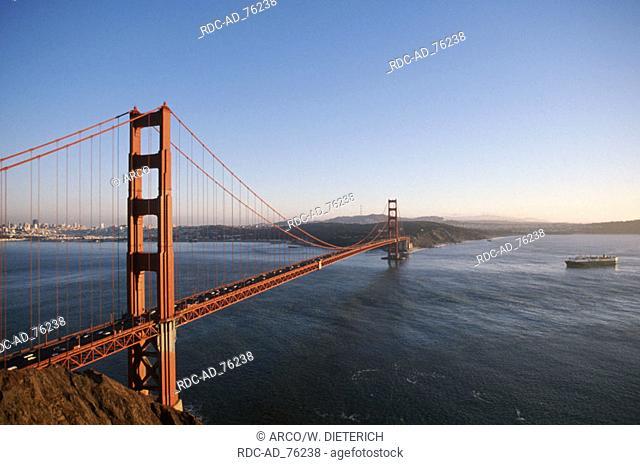Golden Gate Bridge in evening light and ship on San Francisco Bay San Francisco California USA
