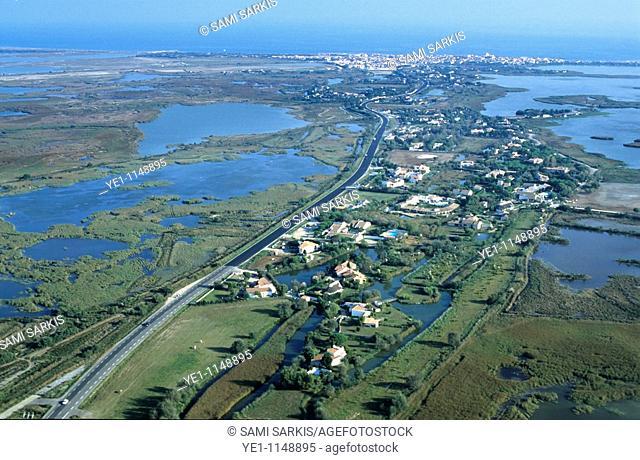 Townscape nestled along the Rhone river delta, Saintes-Maries-de-la-Mer, Camargue, France