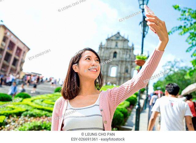 Woman taking picture by mobile phone