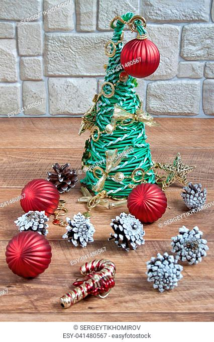 Christmas and New Year decorations are lying on a wooden flooring.Tradition holidays