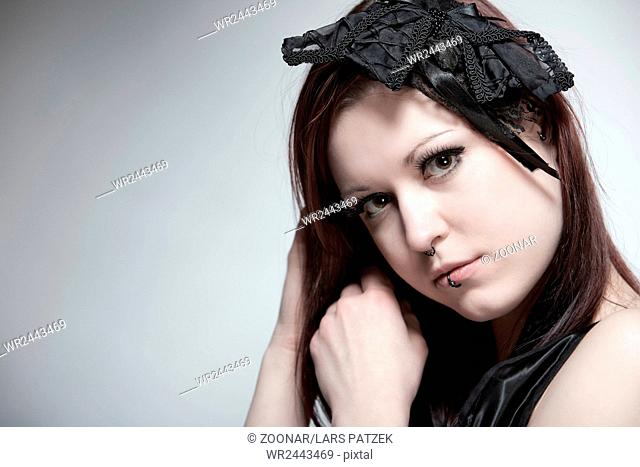 Young woman with vintage headdress