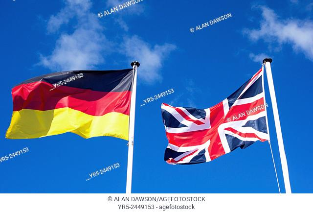 Flags of Germany and United Kingdom against blue sky