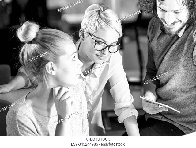 Two young Businesswomans at work trying to fix some errors