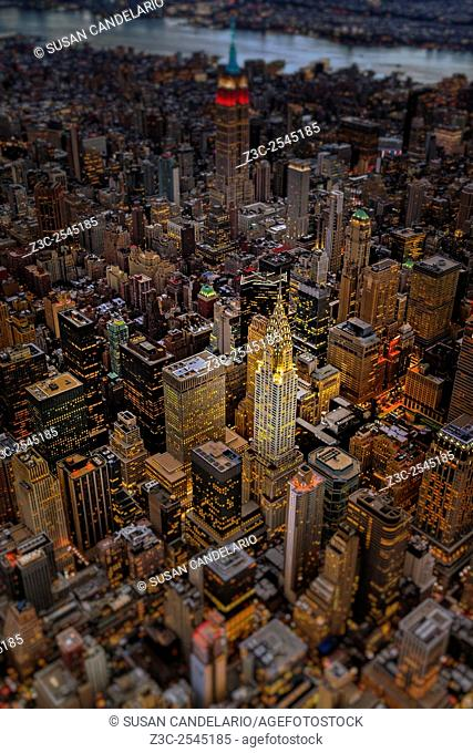 Chrysler Building NYC Skyline - Aerial view of the Art Deco architecture style of the Chrysler Building a de-focused Empire State Building (ESB) and other...