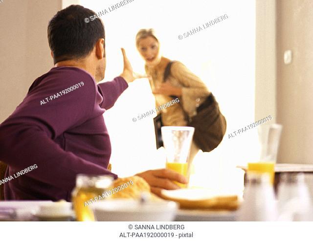 Man gesturing to woman leaving