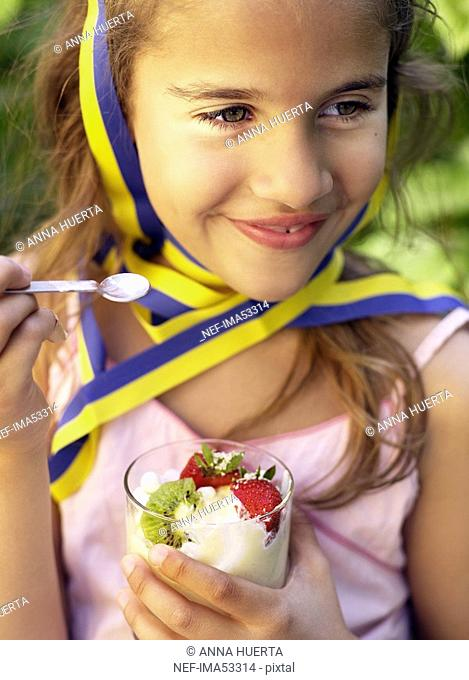 A girl eating a dessert, Sweden