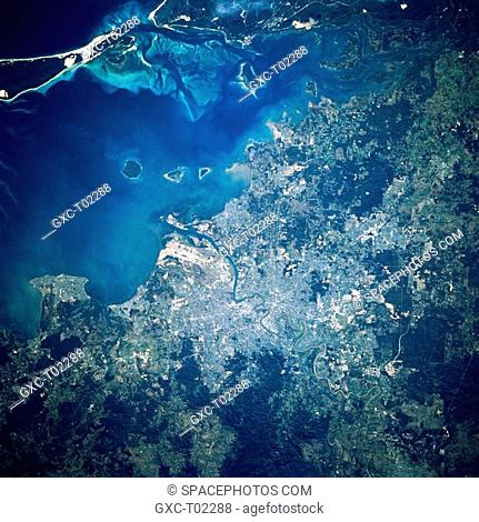 Australia's third largest city, Brisbane near center of image, is located midway up the east coast of Australia. A segment of the Brisbane River is visible as...