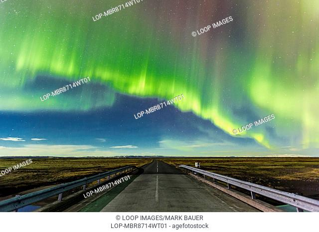 Aurora Borealis over a road near Vik in Southern Iceland