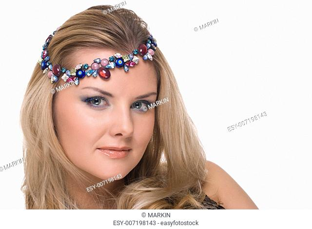 Closeup portrait of beautiful fashion woman with adornment in hair