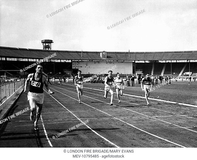 Firefighters in Amateur Athletic Association 4x110 yards senior relay championship final. The winner was D A Hitchman of Birchfield Harriers (C6)