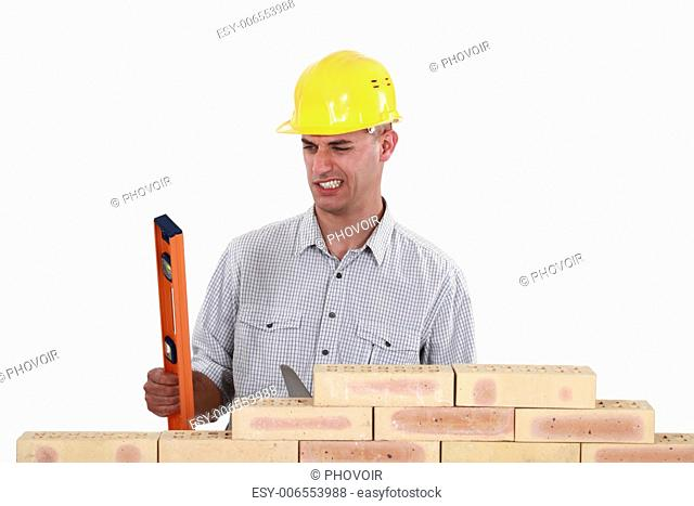 Bricklayer with a spirit level