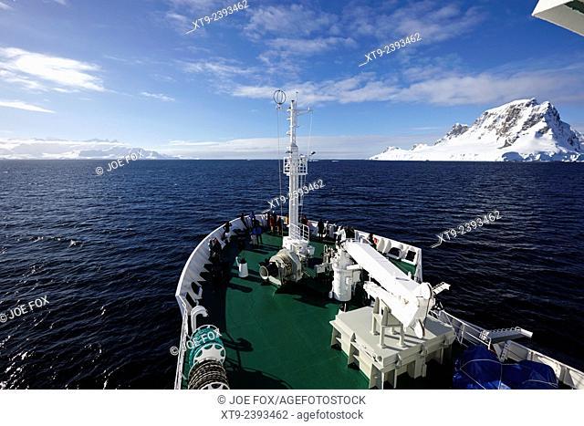 passengers on board ship sailing between anvers island and the antarctic peninsula