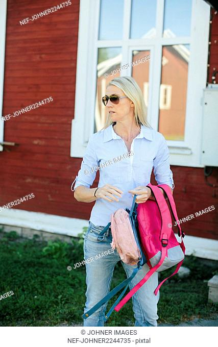 Woman holding backpacks