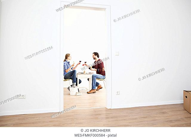 Couple holding glass in new house