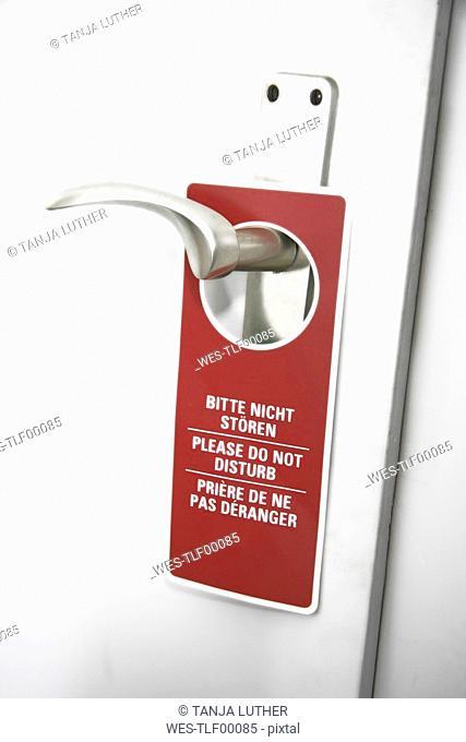 Please do not disturb sign on door handle, close-up