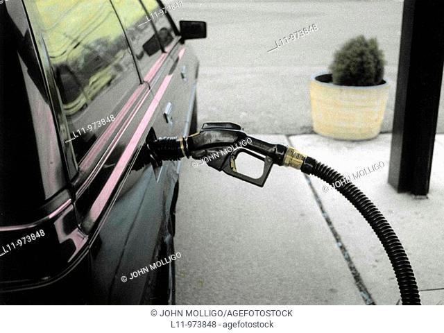 Car at gas pump, hand colored
