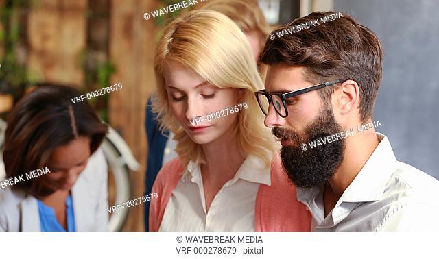 Hipster business people talking together