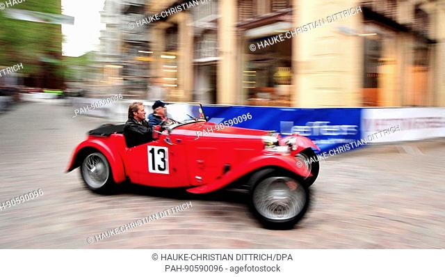Participants start with a vintage car of type HRG 1100 Roadster at the City Grand Prix in Oldenburg (Germany), 11 May 2012. | usage worldwide