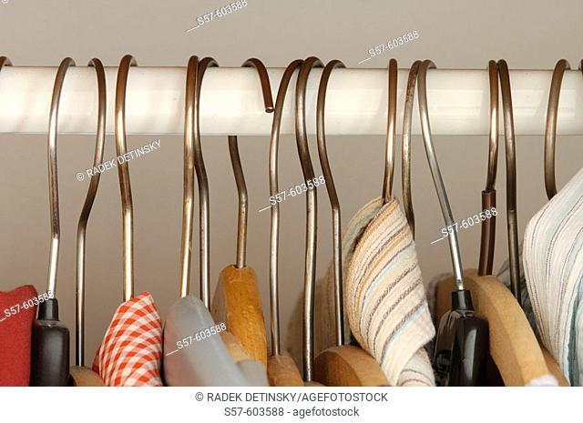Clothes hangers on wardrobe rail