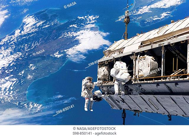 STS-116 Mission Specialists Robert L. Curbeam, Jr. (left) and Christer Fuglesang participate in the first of the mission's three planned sessions of...