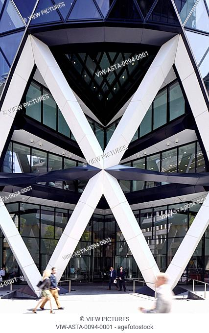 Iconic Entrance to the Gherkin with office workers passing by. Office Space at The Gherkin, London, United Kingdom. Architect: IOR GROUP Interiors