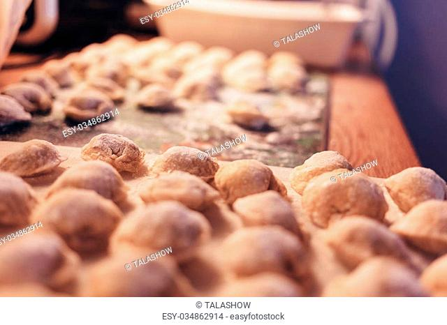Raw Meat dumplings Russian traditional pelmeni with meat. Close up photo