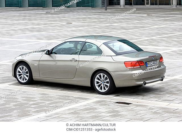 BMW 335i Convertible, model year 2007-, silver, standing, upholding, diagonal from the back, rear view, side view, City, closed top
