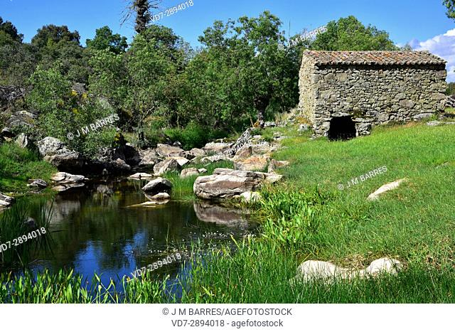 Popular architecture. Watermill (molino Cabildo) building with granite blocks. Badilla, Sayago, Zamora Province, Castilla-Leon, Spain