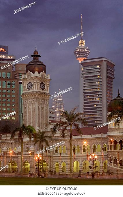 City centre skyline from Merdeka Square with The Sultan Abdul Samad Building in the foreground The Menara Kuala Lumpur and Petronas Towers behind