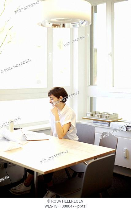 Architect using laptop in her office