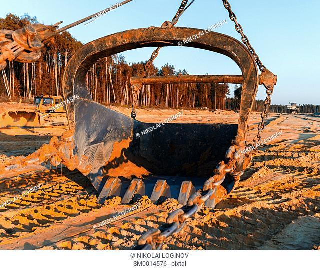 Horizontal vivid sand mining industrial scoop background backdrop