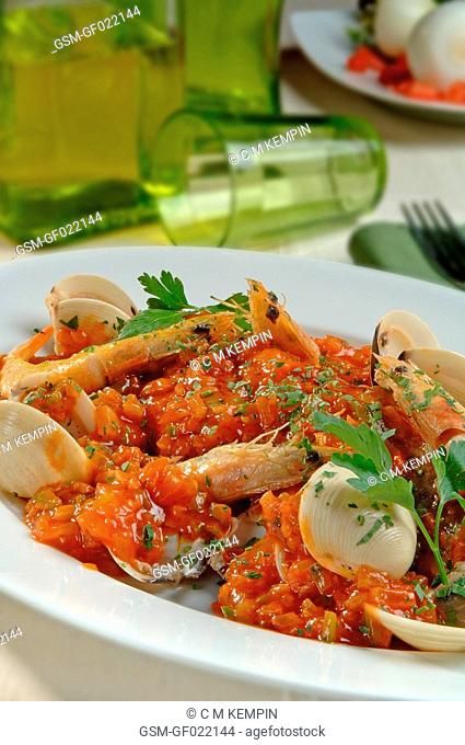 Baked cod with seafood