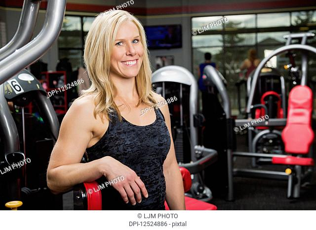 Portrait of an attractive middle-aged business woman who owns a fitness club and is a personal trainer; Spruce Grove, Alberta, Canada