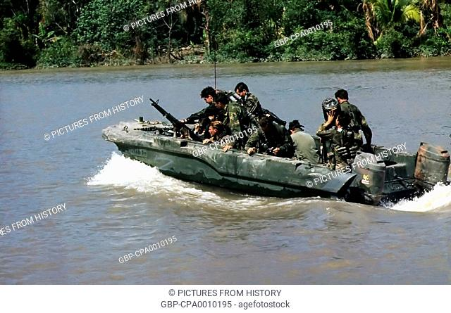 Vietnam: Members of a US Navy SEAL team move down the Hau Giang or Bassac River in a SEAL Team Assault Boat (STAB) near Saigon, November 1967