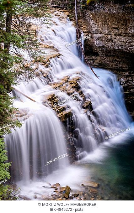Waterfall running in cascades, mountain river in a gorge, Johnston Creek in Johnston Canyon, Bow Valley, Banff National Park, Rocky Mountains, Alberta, Canada