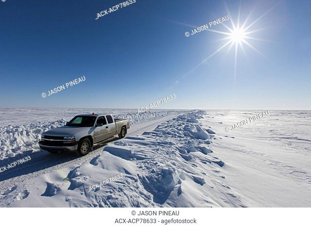 A truck on an ice road on the Arctic Ocean, near Cambridge Bay, Nunavut, Canada
