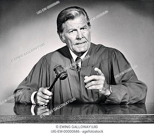 black and white portrait of judge and his gavel