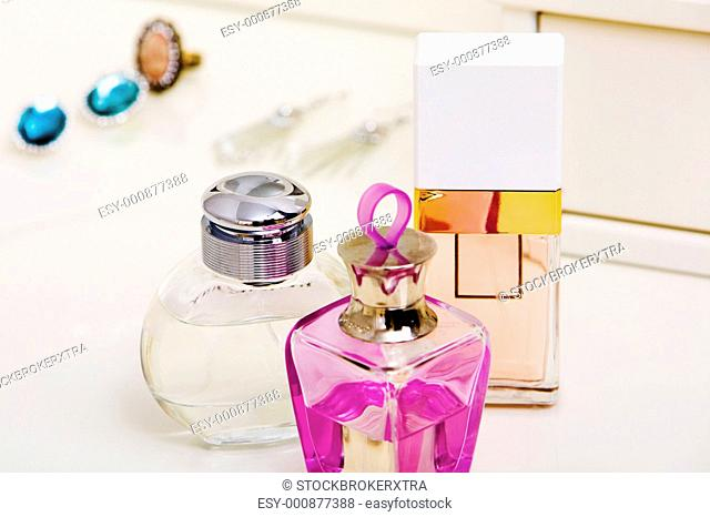 Image of three bottles of scents on lady toiletries table
