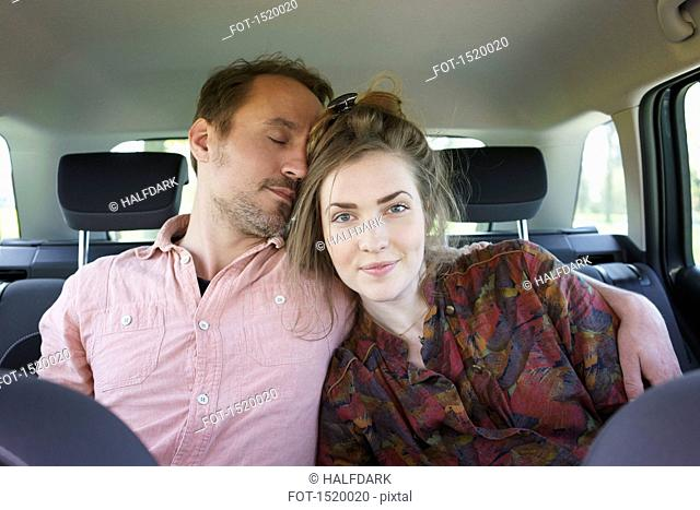 Loving couple relaxing in car
