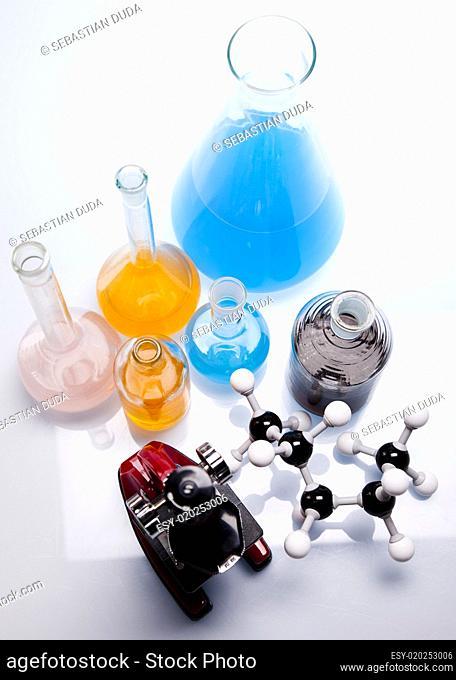 Laboratory glassware containing colorful liquid