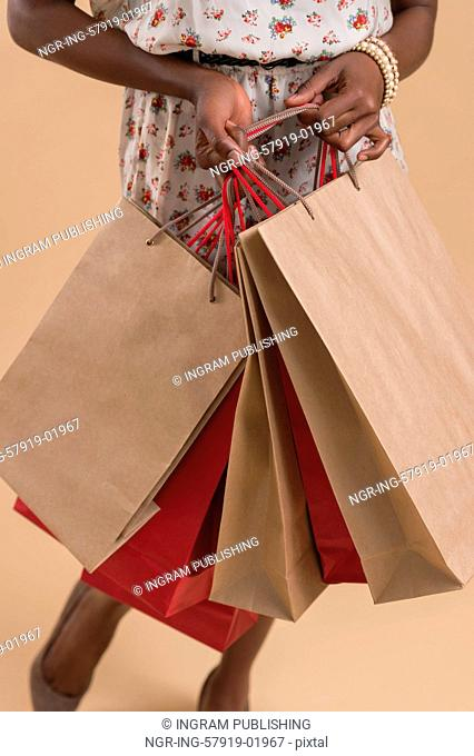 Portrait of cute african woman posing - closeup with shopping bags