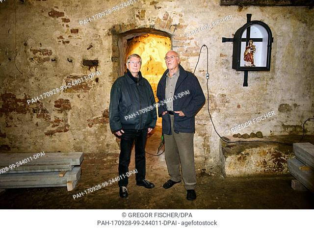 The two contemporary witnesses Ulrich Pfeifer (l) and Hasso Herschel stand in an old basement of the former Oswald Berliner Brewery in Berlin, Germany