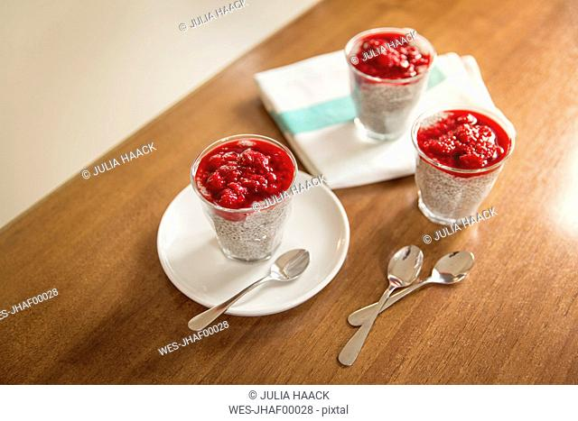 Chia pudding with rasberry topping on kitchen counter