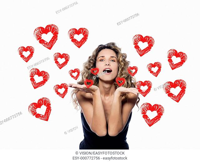 beautiful caucasian woman sending a kiss portrait isolated studio on white background