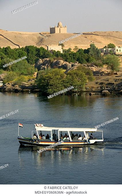 Motorship on the Nile and in the background the Aga Khan mausoleum