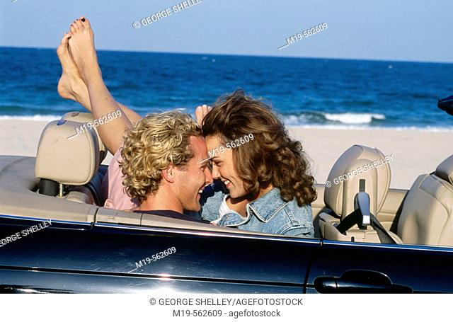 romantic couple in a covertible