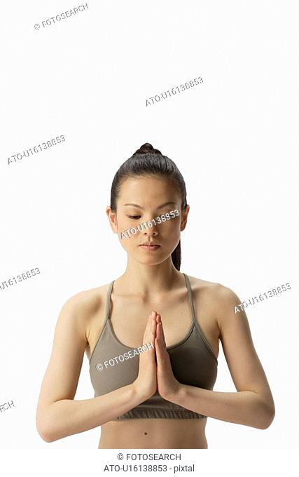 Close-up of a young woman meditating
